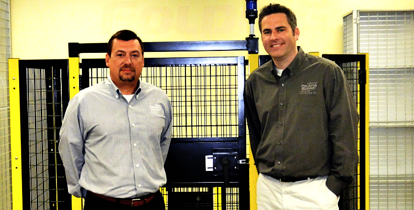 Folding Guard's Pat McMahon (left) and Jason Wynne shown with Saf-T-Fence®, a modular system of steel posts, wire mesh panels, and doors to protect automated machinery and the people who operate it.