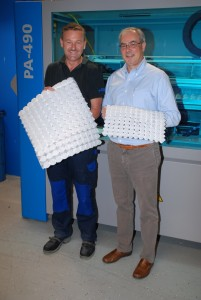 Ruedi Sässler and Roger Straessle display some of the pocket coils manufactured by the Spühl machinery
