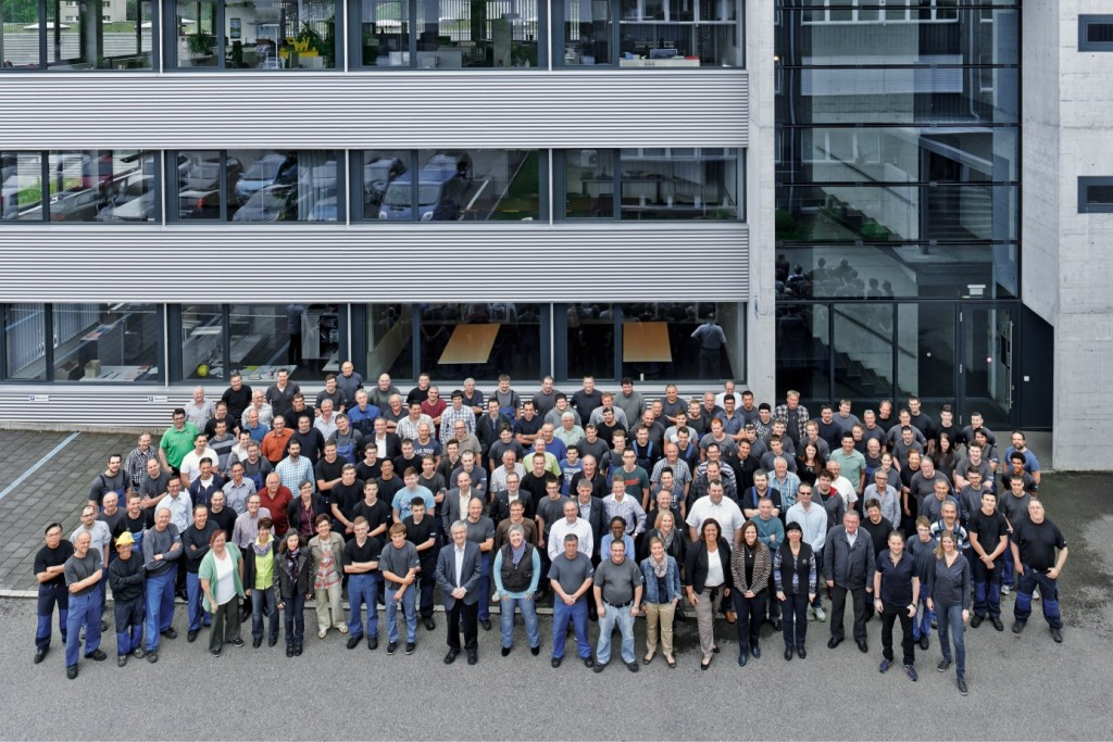 Spühl employees gather in front of the facility.
