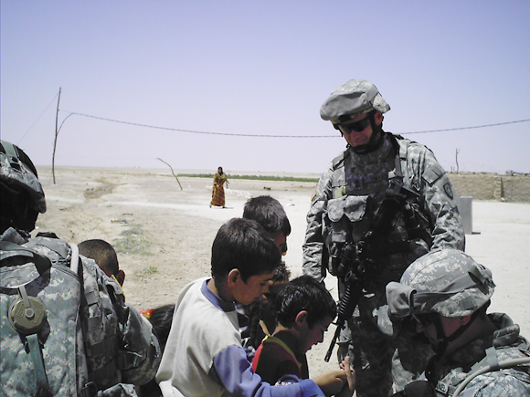 Wayne Hayes with Iraqi children.