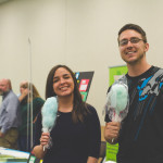 Shela Ward and Evan Younker (both from Creative Services) clearly appreciate the cotton candy.