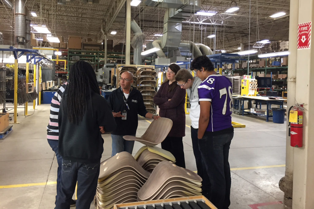 Sicilio Puente, Lead of the of Davidson Plyforms finishing department, gives a tour.
