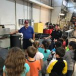 Gary Coffey & Bruce VanHoose from Flex-O-Lators, give a tour to Carthage, MO elementary students.