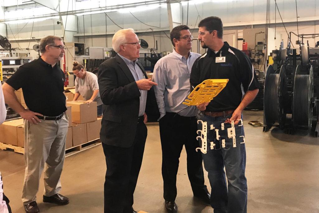 MO Representative Tom Flanigan, L&P CEO Karl Glassman, VP of HR Jason Gorham, and Flex-O-Lators Operations Manager Dwayne Friend.