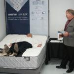 Monroe Spring Branch Manager, George Spires, demonstrates an adjustable bed.