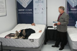 Monroe Spring Branch Manager, George Spires, demonstrates an adjustable bed.