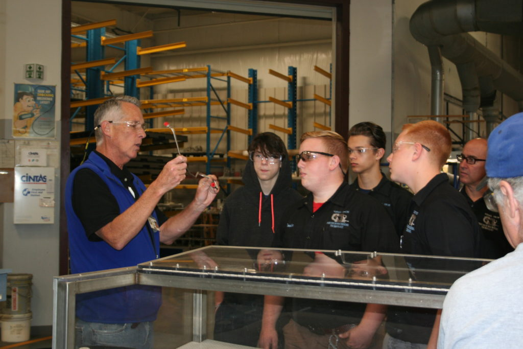 John Corrigan, Machining Manufacturing Manager at Pegasus, gives a tour. (He's been with the company for over 20 years!)